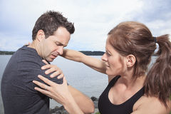 Woman assists to man with injured shoulder Stock Photos