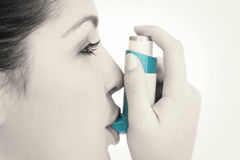 Woman with an asthma inhaler Stock Images