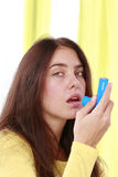 Woman with asthma spray Royalty Free Stock Image