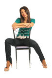 Woman astride a chair Stock Images