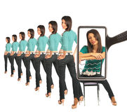 Woman astrides chair, view through magnifier Royalty Free Stock Image
