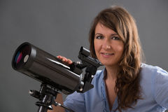 Woman with astronomical telescope Royalty Free Stock Photo