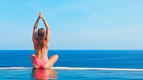 Free Woman At Edge Of Infinity Swimming Pool With Sea View Royalty Free Stock Image - 190342906