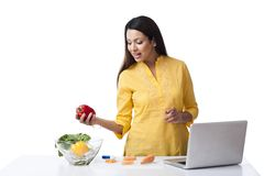 Woman At Kitchen Counter Royalty Free Stock Images