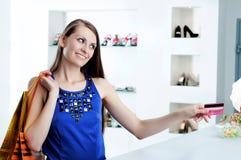 Woman At Shopping Checkout Paying Credit Card Stock Photos