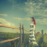 Woman At Sunset Meadow Fence