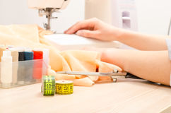 Woman At Work On Sewing Machine Royalty Free Stock Photography