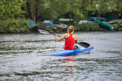 Woman Athlete At Rowing Kayak On Lake During Competition Stock Images