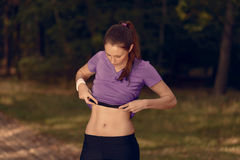 Woman athlete checking her pulse belt Stock Images