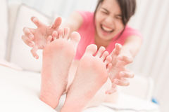 Woman with athlete foot Stock Image