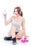 Woman athlete holding a bottle of water Stock Photo