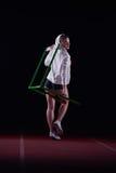 Woman athlete jumping over a hurdles Royalty Free Stock Photos