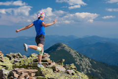 Woman athlete is jumping over stones Royalty Free Stock Photo