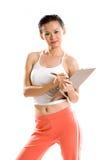 Woman athlete note down records Stock Photos
