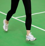 Woman Athlete Runner Feet Running on Green Running Track. Fitness and Workout Wellness Concept. Woman Athlete Runner Feet Running on the Green Running Track royalty free stock photos