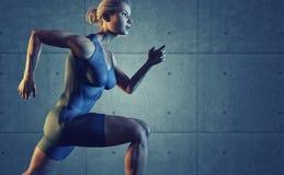 Woman athlete running Stock Image