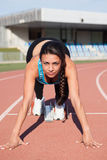 Woman athlete at running track Stock Photos