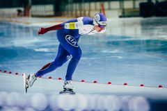 Woman athlete speedskater goes around turn sprint distance Royalty Free Stock Photography