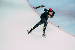 Woman athlete speedskater runs sprint race on turn Royalty Free Stock Photos