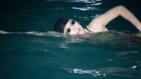 Woman athlete swimming crawl stroke in pool. Royalty Free Stock Photo