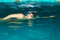 Woman athlete swimming crawl stroke in pool. Royalty Free Stock Photo