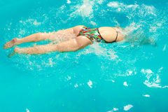 Woman athlete swimming crawl stroke in pool. Royalty Free Stock Photos