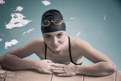 Woman athlete in swimming pool water. Sport. Stock Photos