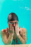 Woman athlete in swimming pool water. Sport. Stock Photography