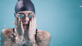 Woman athlete in swimming pool water. Sport. Stock Image