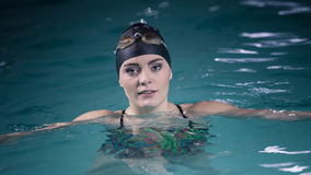 Woman athlete in swimming pool water. Sport. Stock Photo