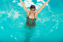 Woman athlete in swimming pool water. Sport. Stock Images