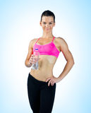 Woman athlete with water bottle Royalty Free Stock Photo