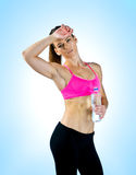Woman athlete with water bottle Royalty Free Stock Images