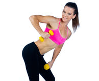 Woman athlete with weights Royalty Free Stock Images