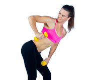 Woman athlete with weights Stock Photo