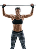 Woman with athletic body doing exercises with barbell isolated on white background. Strength and motivation Royalty Free Stock Photo
