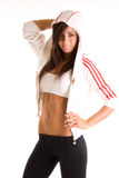 Woman in athletic clothes. Confident 19 year old young woman, dressed in athletic clothes.  Isolated against a white background Stock Images