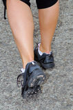 A woman with an athletic pair of legs going for a jog Stock Image