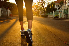 Woman with an athletic pair of legs going for a jog Stock Photos