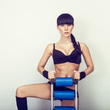 woman with athletic trainer press Stock Photography