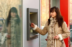 Woman and a ATM Royalty Free Stock Image
