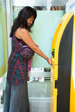 Woman at ATM Stock Photos