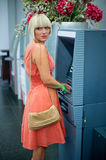 Woman at atm machine Stock Photo