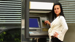 Woman at atm machine outdoor Royalty Free Stock Photography
