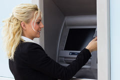Woman at ATM machine, withdrawing money Stock Image
