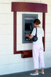 Woman at ATM Royalty Free Stock Photos