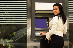 Woman at atm Royalty Free Stock Images