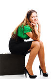 Woman and attache case. A cheerful young woman posing with a black leather attache case royalty free stock photo