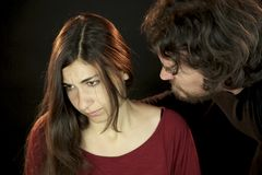 Woman attached by scary man. Woman attached by scary men with beard and long hair Stock Images