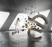Woman attacking euro symbol . Mixed media Stock Photo